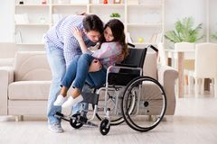 The young family taking care of each other. Young family taking care of each other Royalty Free Stock Photography