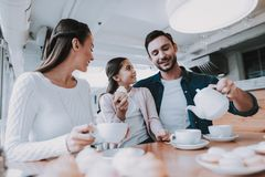 Young Family. Tea Time. Cafe. Happy Together. Cup. Good day with family. Happiness day with young woman. together women and man. love day with family. Cafe and stock image