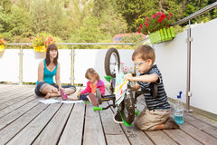 Young family on terrace Stock Image