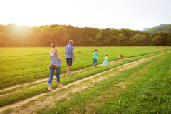 Young family with their pet dog, golden retriever Royalty Free Stock Images