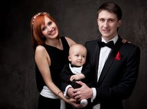 Young family with their son between them Stock Photo