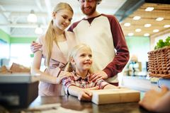 Family at cash register Royalty Free Stock Images