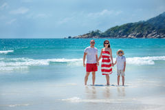 Young family of three having fun tropical beach Stock Photography