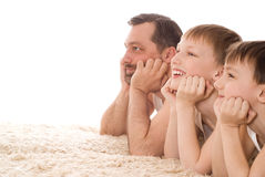 Young family three lying Royalty Free Stock Images
