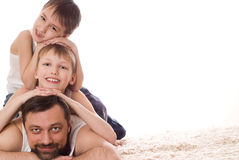 Young family three lying Royalty Free Stock Photo