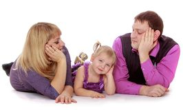 Young family of three people lying on the floor Stock Photography