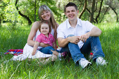 Young family of three on a picnic Royalty Free Stock Photos
