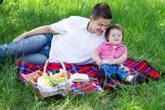 Young family of three on a picnic Royalty Free Stock Images