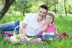 Young family of three on a picnic Stock Images