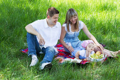 Young family of three on a picnic Stock Image