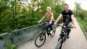 Young Family Of Three Riding Bicycles Along Path stock footage