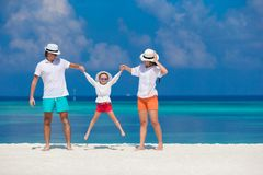 Young family of three on white beach during Stock Photography