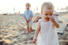 Young family with toddler children having fun on beach on summer holiday. royalty free stock images