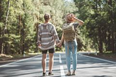 Young family traveling active adventure vacations. Traveler couple in love enjoying holding hands each other and looking forward to a joint journey. Young family stock image