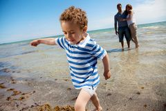 Young Family on a Tropical Beach Stock Photography