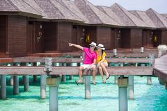 Young family of two on beach jetty at tropical Royalty Free Stock Photos