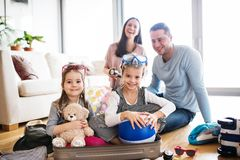 Young family with two children packing for holiday. Stock Photography