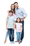 Young family with two children standing together Royalty Free Stock Images