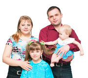Young family with two daughters royalty free stock photos