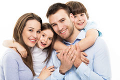 Young family with two kids. Young family with two children on white background stock photography