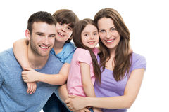 Young family with two kids. Young family with two children on white background royalty free stock photos