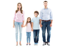 Young family with two kids. Young family with two children on white background royalty free stock photo