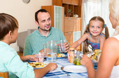 Young family with two kids dining Royalty Free Stock Photography