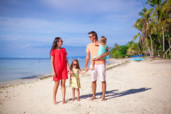 Young family with two kids on summer beach Royalty Free Stock Photos