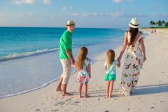 Young family with two kids on tropical vacation in the evening Stock Photo