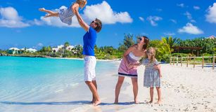 Young family with two kids at tropical white beach Royalty Free Stock Photography