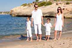 Young family with two kids on vacation Stock Images