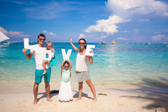 Young family and two kids with word LOVE on Royalty Free Stock Photo