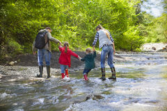 Young family with two little daughters on mountain trek Royalty Free Stock Images