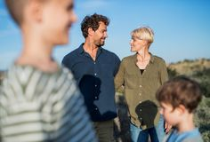 Young family with two small children standing outdoors in nature. Young family with two small children standing outdoors in nature in Greece royalty free stock photos