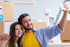 Young family unpacking at new house with boxes stock image