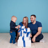 Young family unpacking presents Stock Photo