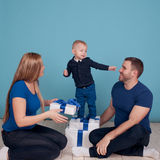 Young family unpacking presents Royalty Free Stock Image