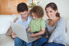 Young family using a laptop Stock Photography