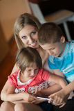 Young Family Using A Tablet To Make Future Plans Stock Photos