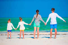 Young family on vacation. Happy father, mother and their active kids having fun on their summer beach holidays Royalty Free Stock Photography