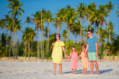 Young family on vacation. Happy father, mother and their cute kids having fun on their summer beach holidays Royalty Free Stock Images
