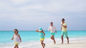 Young family on vacation have a lot of fun on the beach. Slow motion. stock video footage