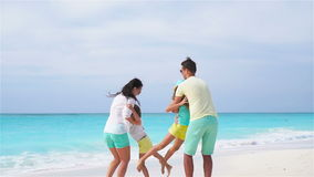 Young family on vacation have a lot of fun on the beach. Slow motion. stock video