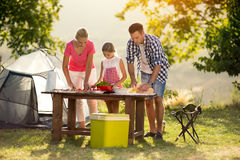 Young family on vacation having barbecue Stock Images