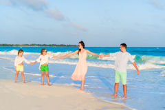 Young family on vacation on the sunset royalty free stock photos