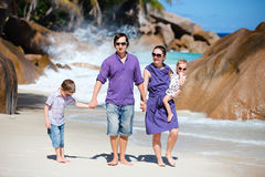 Young family walking along beach Stock Photo