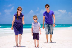 Young family walking along beach Stock Image