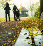 Young Family  Walking Through Harrow Parkin in Autumn Royalty Free Stock Images
