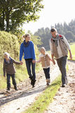 Young family walking in park. Holding hands smiling Royalty Free Stock Images
