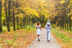 Young family walking in the park an autumn day royalty free stock photography